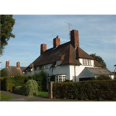 The Arts and Crafts style of architecture placed a strong emphasis on regional vernacular architecture and exaggerated 'traditional' elements such as tall chimneys and steeply pitched roofs