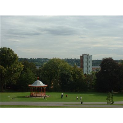 Southerly views over the bandstand towards Shuttleworth House, a tall block of flats and Doughty's Mill, a long building with a series of brick work in different shades creating an archway appearance with windows situated within these.