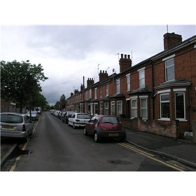 Red brick terraced houses on Kingsway, which was the only one of a scheme of three roads proposed in 1911 that was actually built. The properties are two-storey and have bay windows on the ground floor.