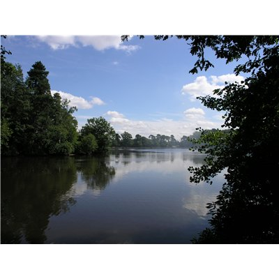 The lake at Hartsholme Country Park, originally created in 1848 as a reservoir to help supply Lincoln with drinking water which is surrounded by greenery.