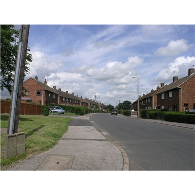 View of semi-detached and rows of red-brick two-storey properties along Laughton Way that were built as part of a large development of local authority housing between around 1950 and 1972.