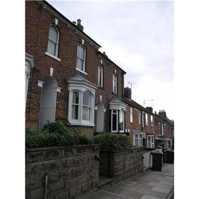 Row of terraced houses with bay windows and access via steps up to them