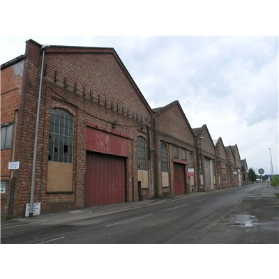 Inter-war warehousing on Beevor Street. They are positioned at the back of the footway and have dogtooth brickwork decoration in the gable ends