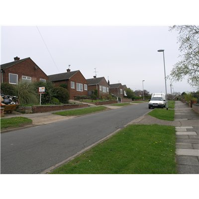 Bungalows along the north of Hillside Avenue. Streets have relatively narrow carriageways with wide verges and pavements, which, together with medium to large setbacks and a consistent building line and height, create a limited sense of enclosure and a fe