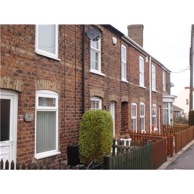 Row of two storey red brick Victorian terraces with beige brick string courses and lintels