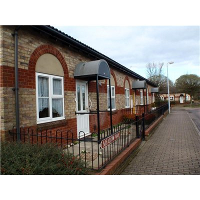 Distinctive property style with semi circular false window lintels and porches on Meadow Way