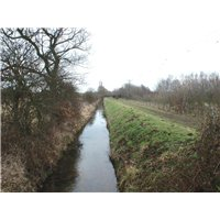 Long channelled watercourse running adjacent to public footpath